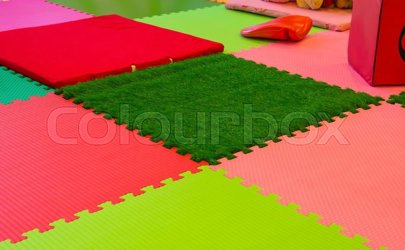Rubber foam for baby play in playroom, stock photo