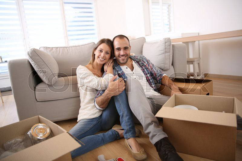 Young adults moving in new home, stock photo