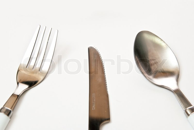 Knife Fork Spoon In The Table Grey Background Stock