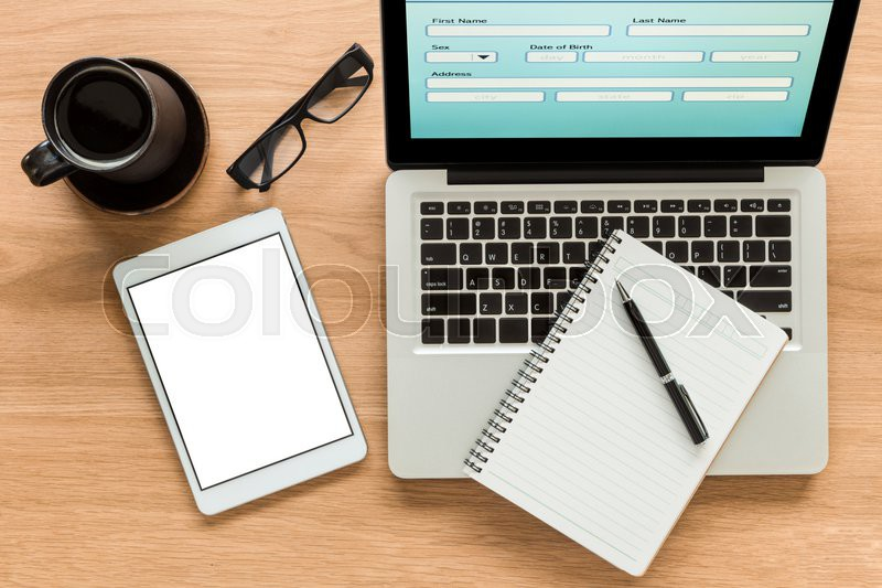 Open laptop shows blank information form and digital tablet with isolate screen on wooden table - Top office ordinateur portable ...