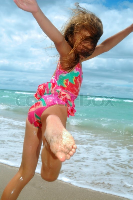 Little Girl Playing And Dancing At The Stock Photo