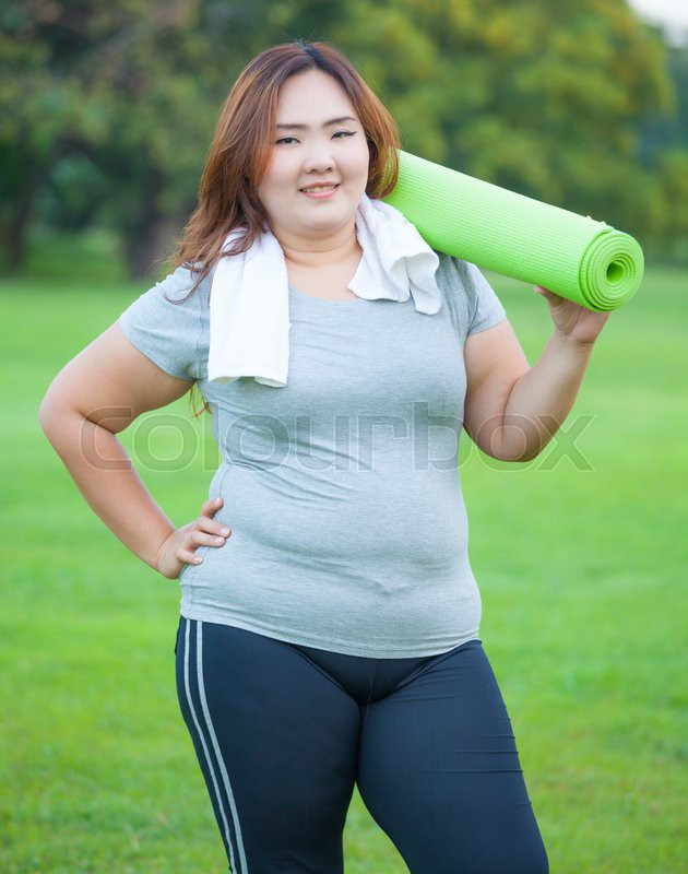 Pretty Fat Asian Woman Going To Work Out With Her Yoga Mat  Stock Photo  Colourbox-2659