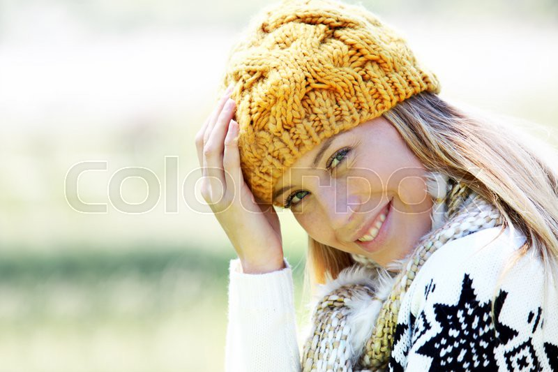 Portrait of blond woman in winter clothes and accessories, stock photo
