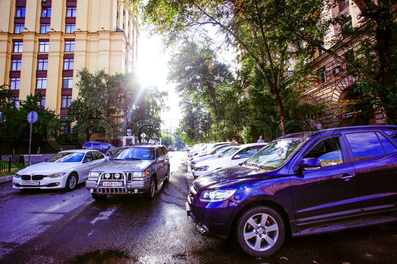 RUSSIA, 8 AUGUST 2014, Photo of parking cars in Moscow city and sunlight, stock photo