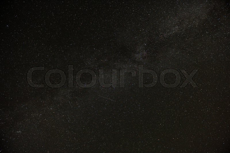 A real dark night sky with plenty of stars and flying satellites, stock photo