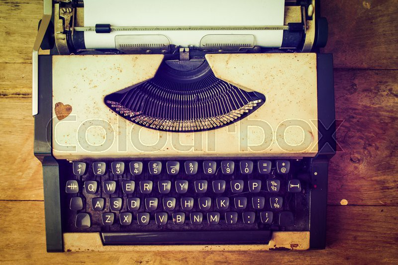 Vintage typewriter and telephone , notebook on the wood desk in vintage color tone, stock photo