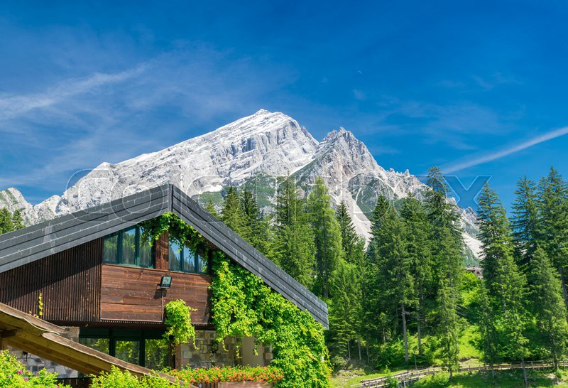 Beautiful building in the middle of mountains valley, stock photo