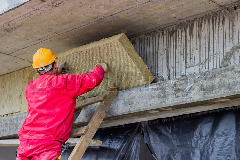 Man Installing External Wall Insulation Mineral Rockwool