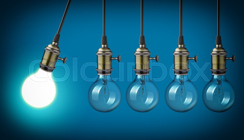 Perpetual motion with vintage light bulbs , stock photo