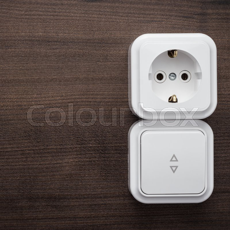 Light switch and outlet on the wall Stock Photo Colourbox