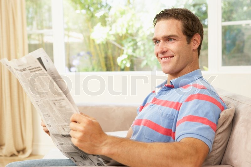 https://www.colourbox.com/preview/1265207-man-reading-newspaper-at-home.jpg