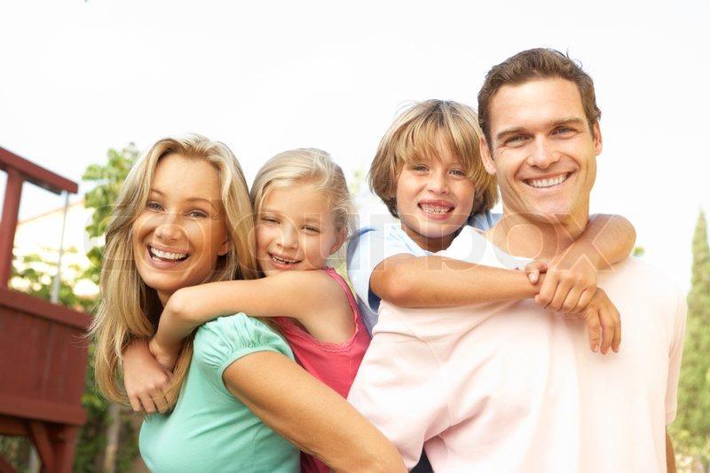 Portrait of Happy Family In Garden | Stock Photo | Colourbox