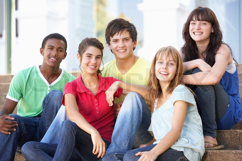 Group Of Teenage Friends Sitting On College Steps Outside | Stock ...