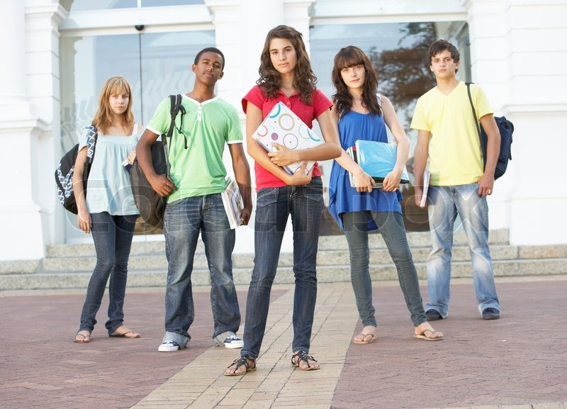 Group Of Teenage Students Standing Outside College Building ...