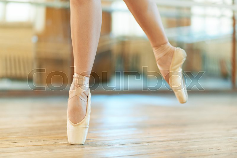 Beautiful legs of a dancer in pointe, stock photo