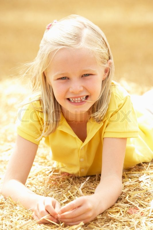 Portrait Of Girl Laying In Summer Harvested Field | Stock ...