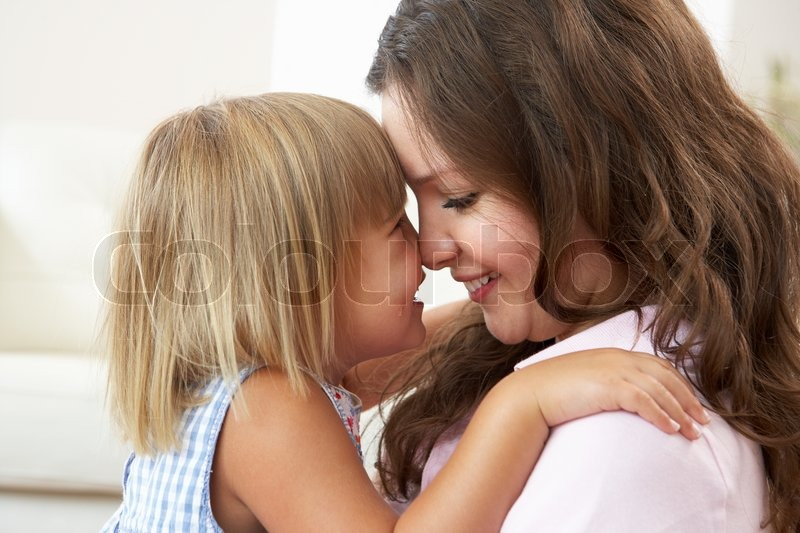 Close Up Of Affectionate Mother And Daughter At Home, stock photo