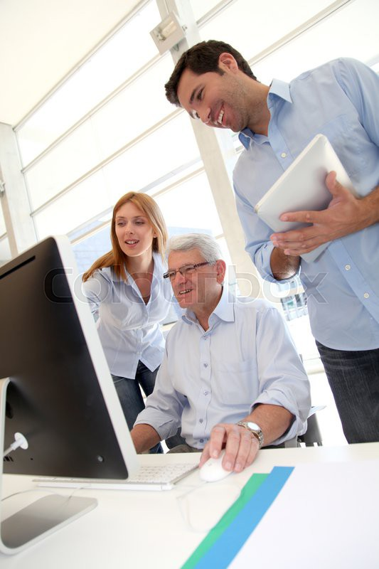Senior people attending business training, stock photo