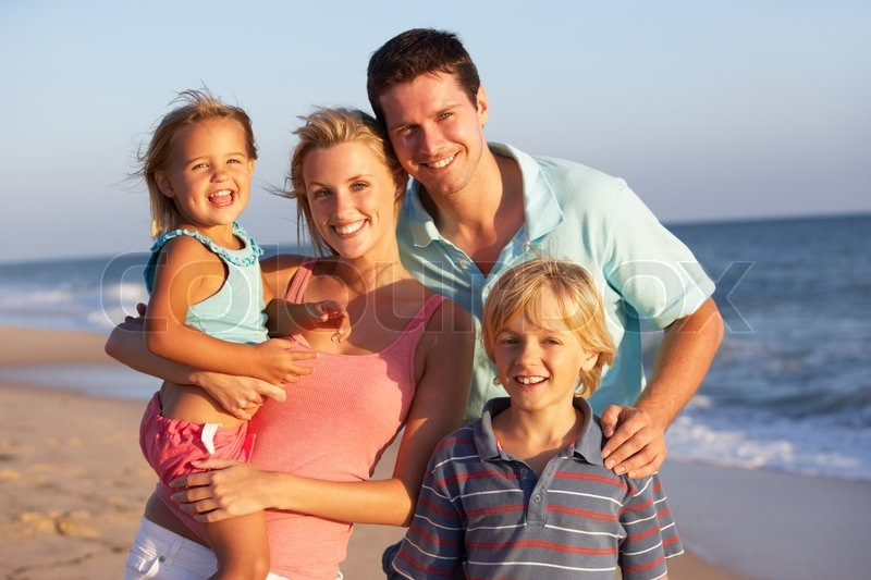 Stock image of 'Portrait Of Family On Beach Holiday'