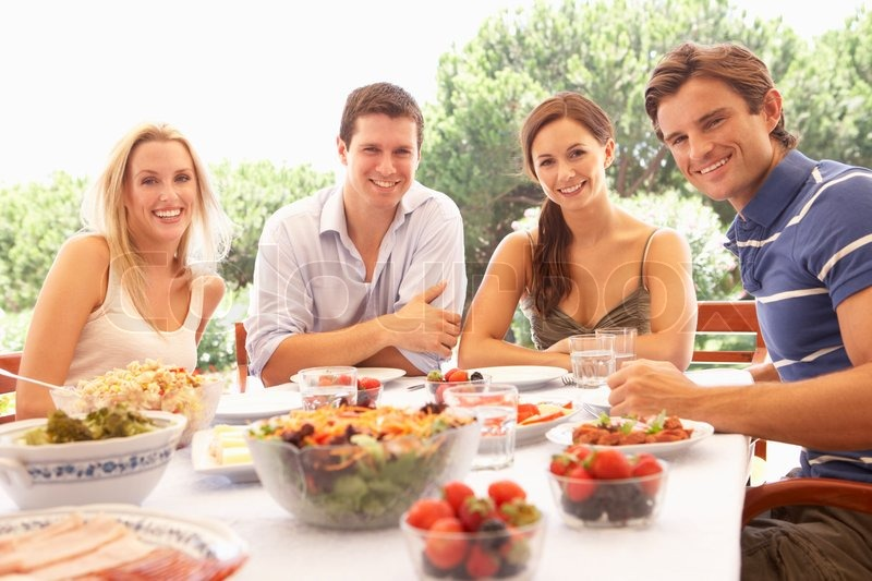 Two young couples eating outdoors stock photo colourbox for Repas vite fait entre amis