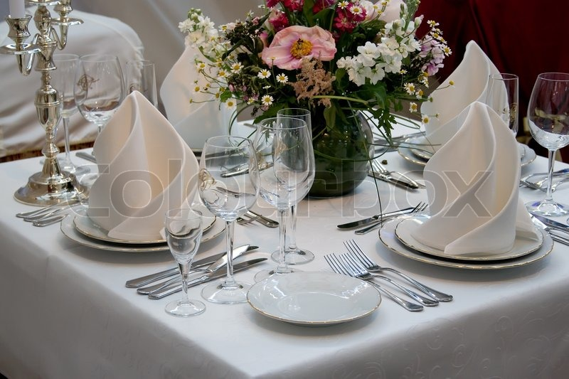 A restaurant table set up with wine glass and cutlery stock photo & A restaurant table set up with wine glass and cutlery. | Stock Photo ...