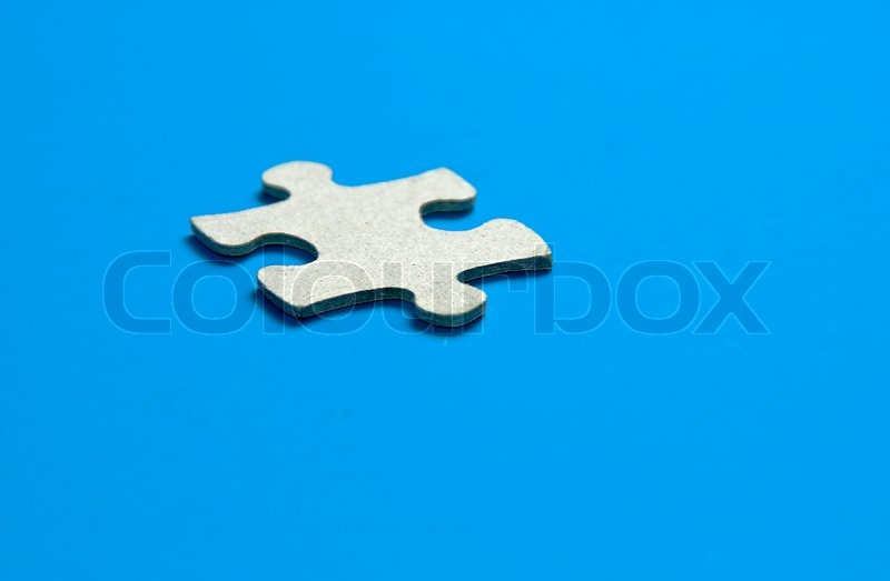 Missing puzzle piece the key to success, stock photo