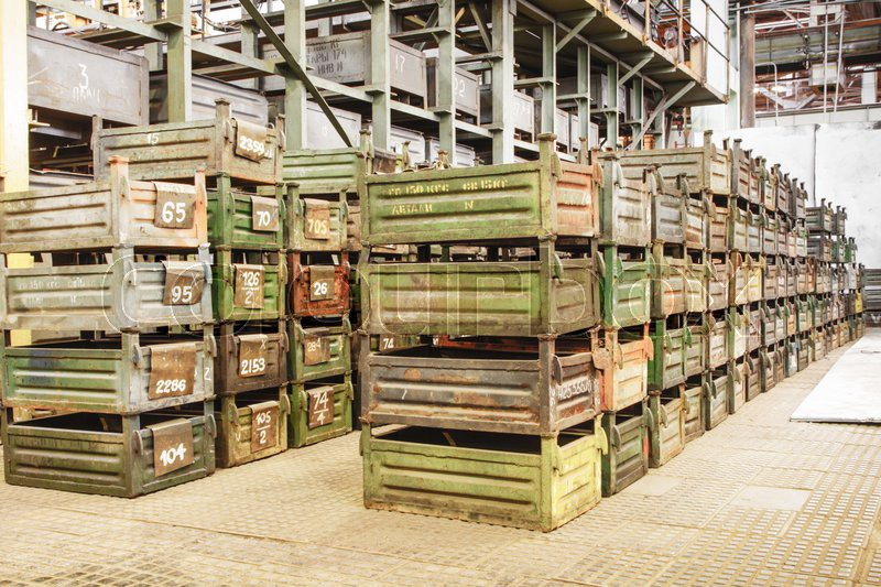Big storage room with metal boxes in factory, stock photo