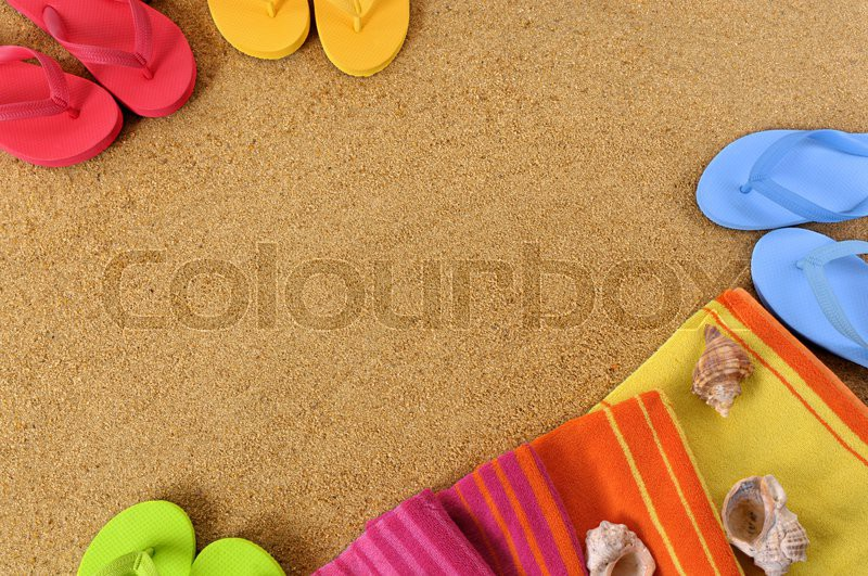 Beach background with towel and flip flops. Space for copy, stock photo