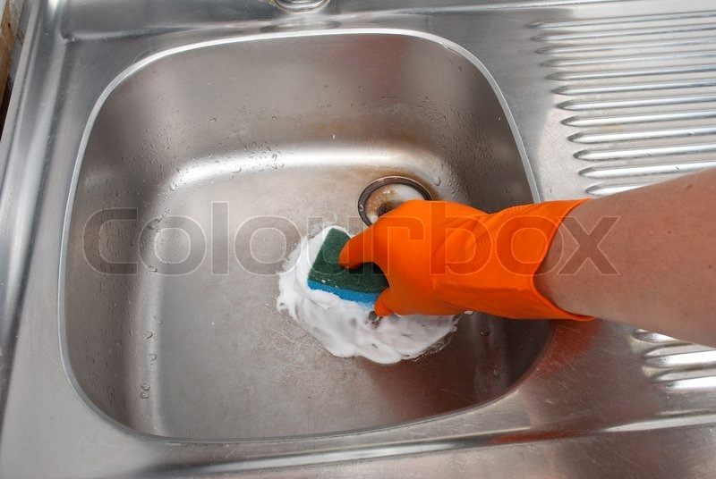 Person cleaning the kitchen sink with a glove | Stock Photo ...