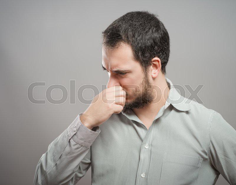 Mature man suffering from sinus pressure pain, stock photo