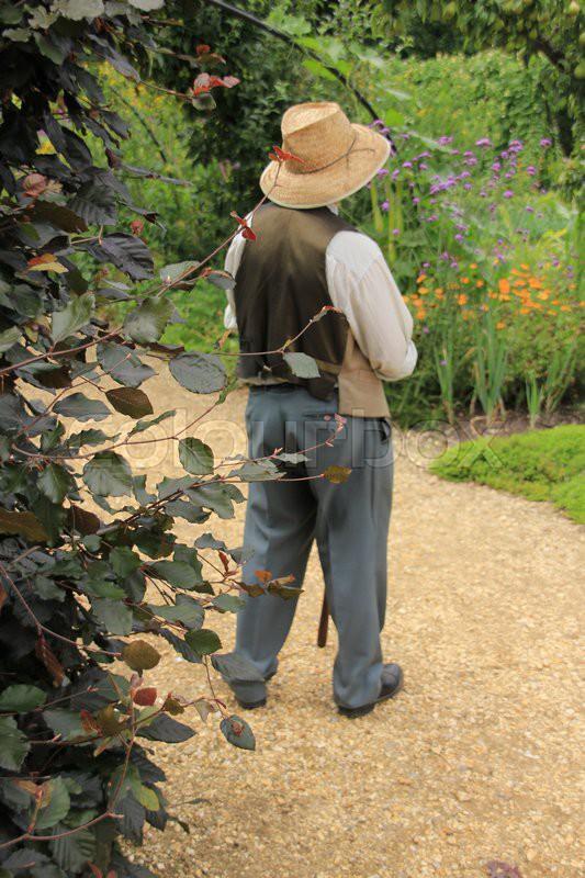 The gardener has fun in the wonderful garden in the summer in England, stock photo
