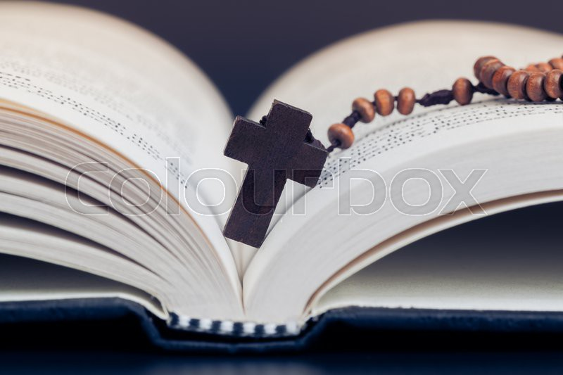 Christian cross necklace on Holy Bible book, Jesus religion concept as good friday or easter festival, stock photo