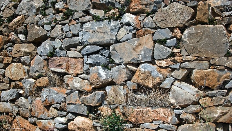 alte mauer aus steinen im alten griechenland insel kreta als wallpaper hintergrund stockfoto. Black Bedroom Furniture Sets. Home Design Ideas