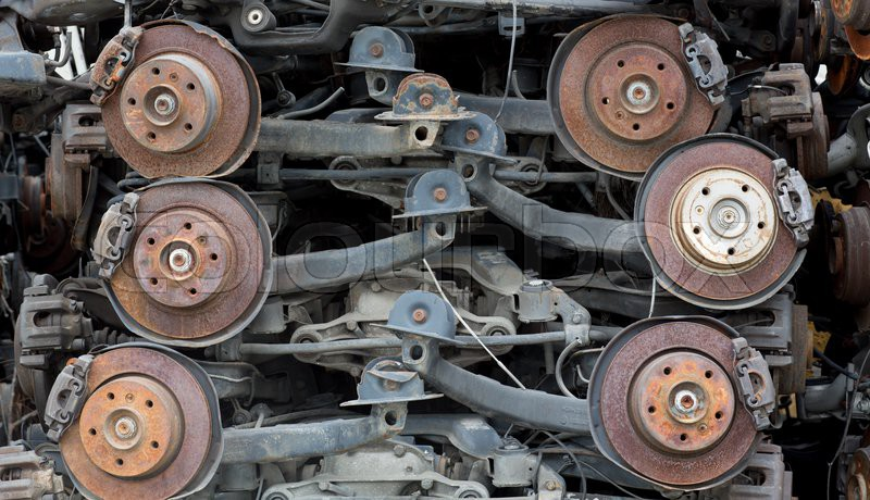 Stack of rusted metallic car parts in garage, stock photo