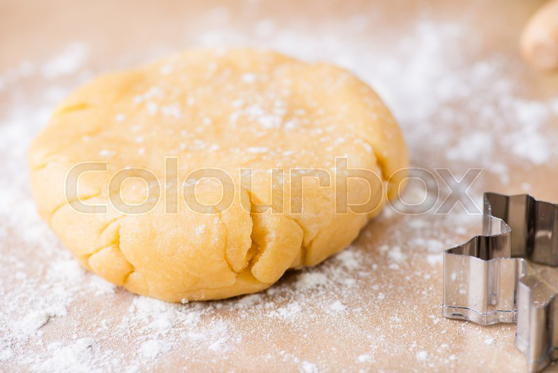 Shortcrust pastry dough, unrolled and unbaked on a floured surface, closeup, selective focus, stock photo