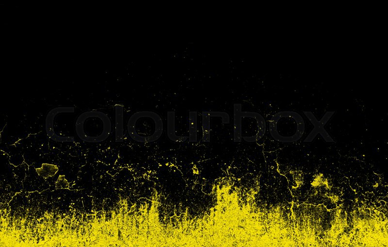 Dynamic bright yellow splashes on a black background, stock photo