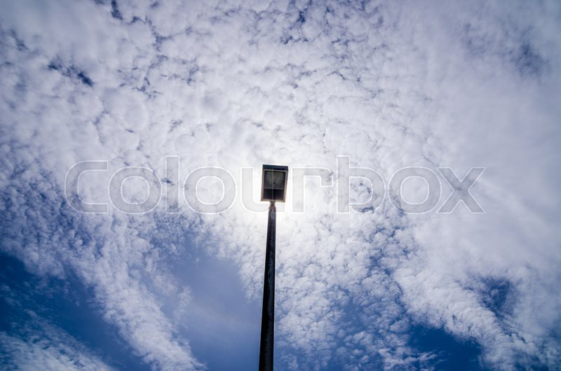 Black Light pole in the blue sky, stock photo