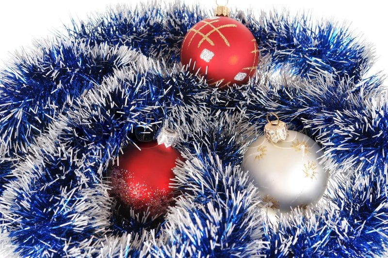 Multi-coloured Christmas-tree decorations lay on a garland | Stock ...