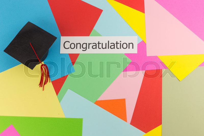graduation cap and word congratulation on colorful paper background