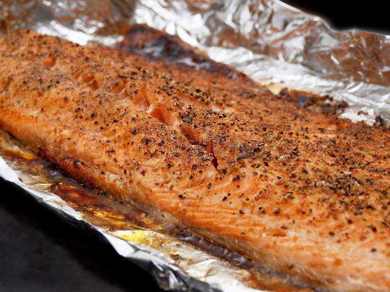 Clouseup of grilled red fish with seasoning in aluminum for Grilled fish seasoning