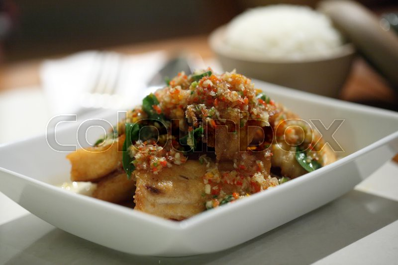 Stock image of 'Thai food fired fish with spicy sauce'