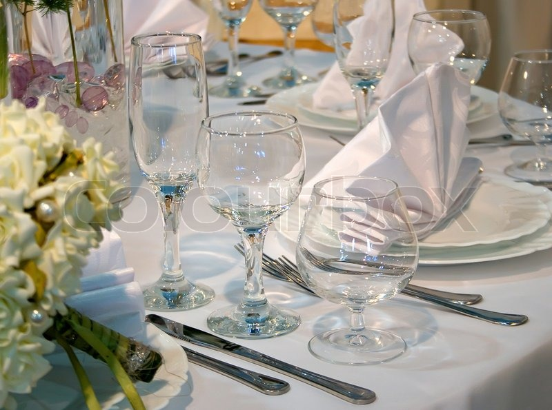 A Restaurant Table Set Up With Wine Glass And Cutlery Stock Photo - How to set a table in a restaurant