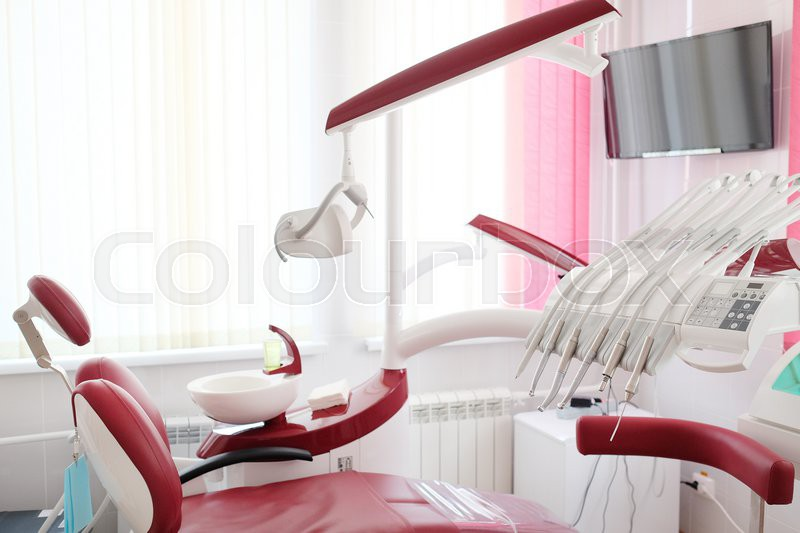 Dental clinic interior design with red chair and tools for Dental clinic interior designs
