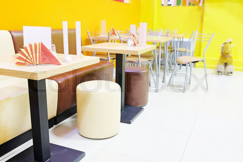Modern restaurant interior with leather sofas stock