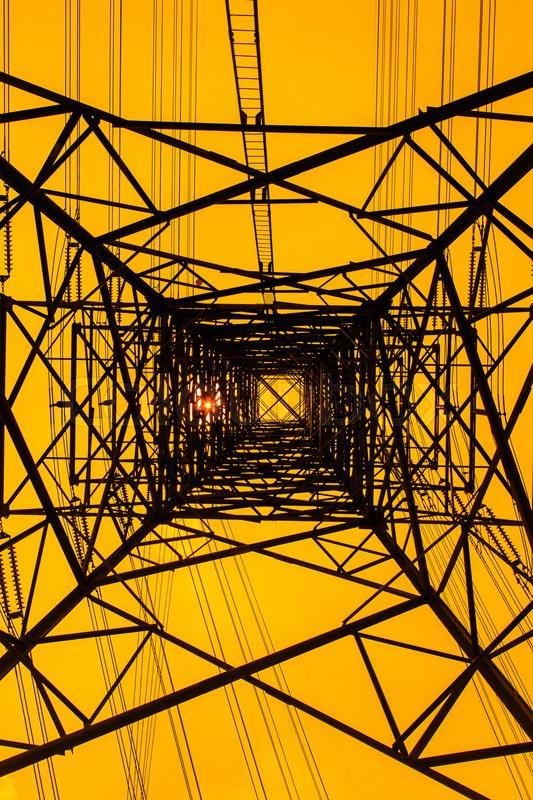Silhouettes Electricity pylon - light pole and sun, stock photo