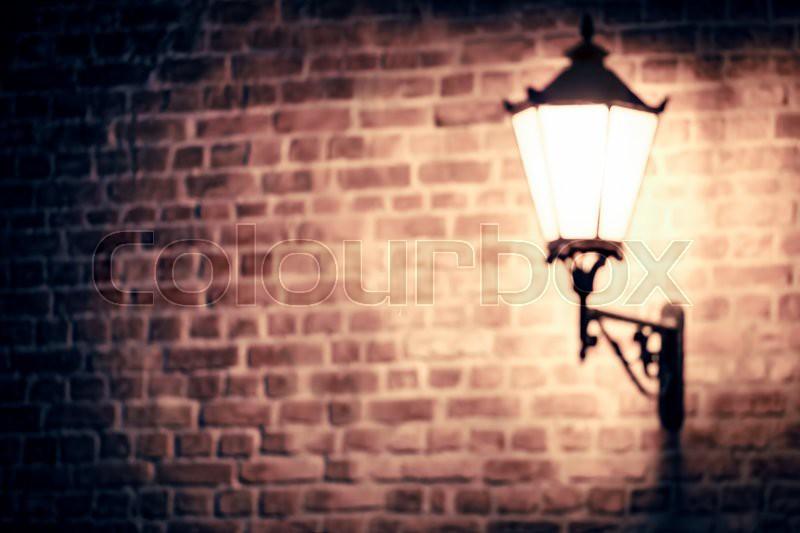 Lantern On Brick Wall Of Old City Blur Stock Photo