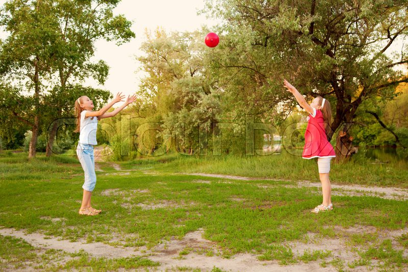 Kids Playing In A Suburban Neighborhood Two Sisters Or