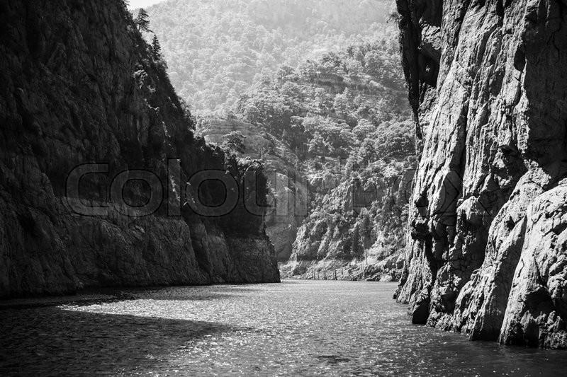 Rocks of Green Canyon lake in Turkey, black and white photo, stock photo
