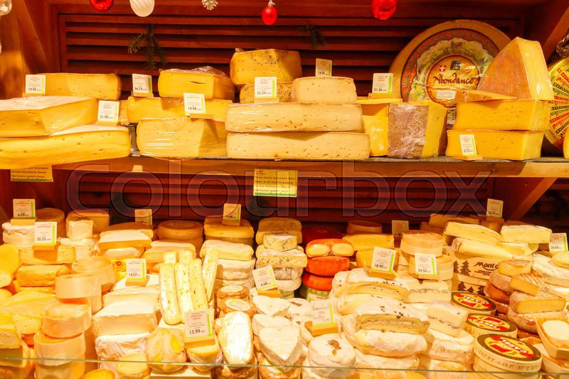 Paris, France - December 22, 2014: French cheese shop with many kinds of cheeses. French cheese is one of the most popular foods in the country, stock photo