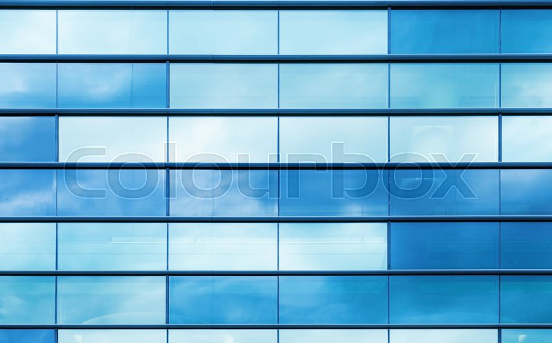 modern office building wall made of blue glass and steel